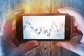 Mobile Forex Trader. Financial Trading Application Concept. Trader Watching Forex Indexes on His Smartphone. poster