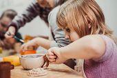 children's hands sculpts clay crafts pottery school poster