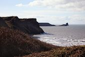 Worm's Head as seen from Rhossili Bay, Rhossili, on the west Gower Peninsular, West Glamorgan, Wales, UK, a popular Welsh coastline attraction for tourist visitors of outstanding beauty poster