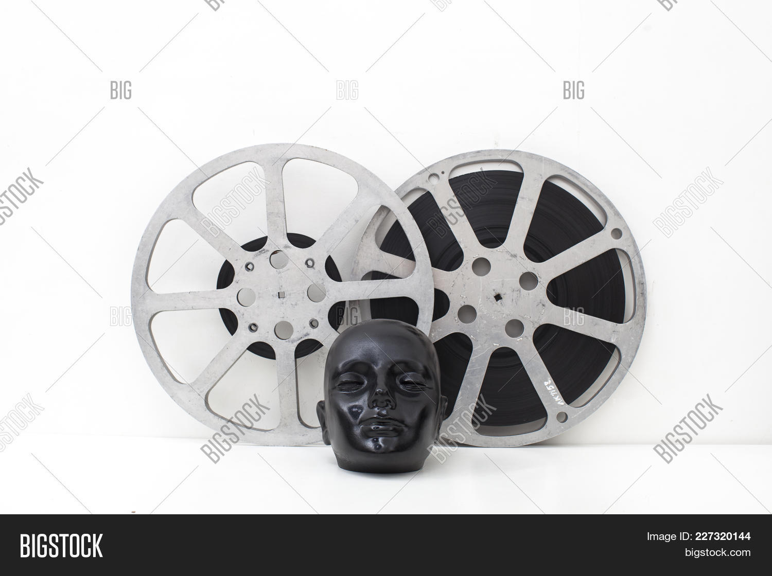 Film reels old movies image photo free trial bigstock film reels of old movies and black dummy head on white backgroundncept cinema altavistaventures Choice Image