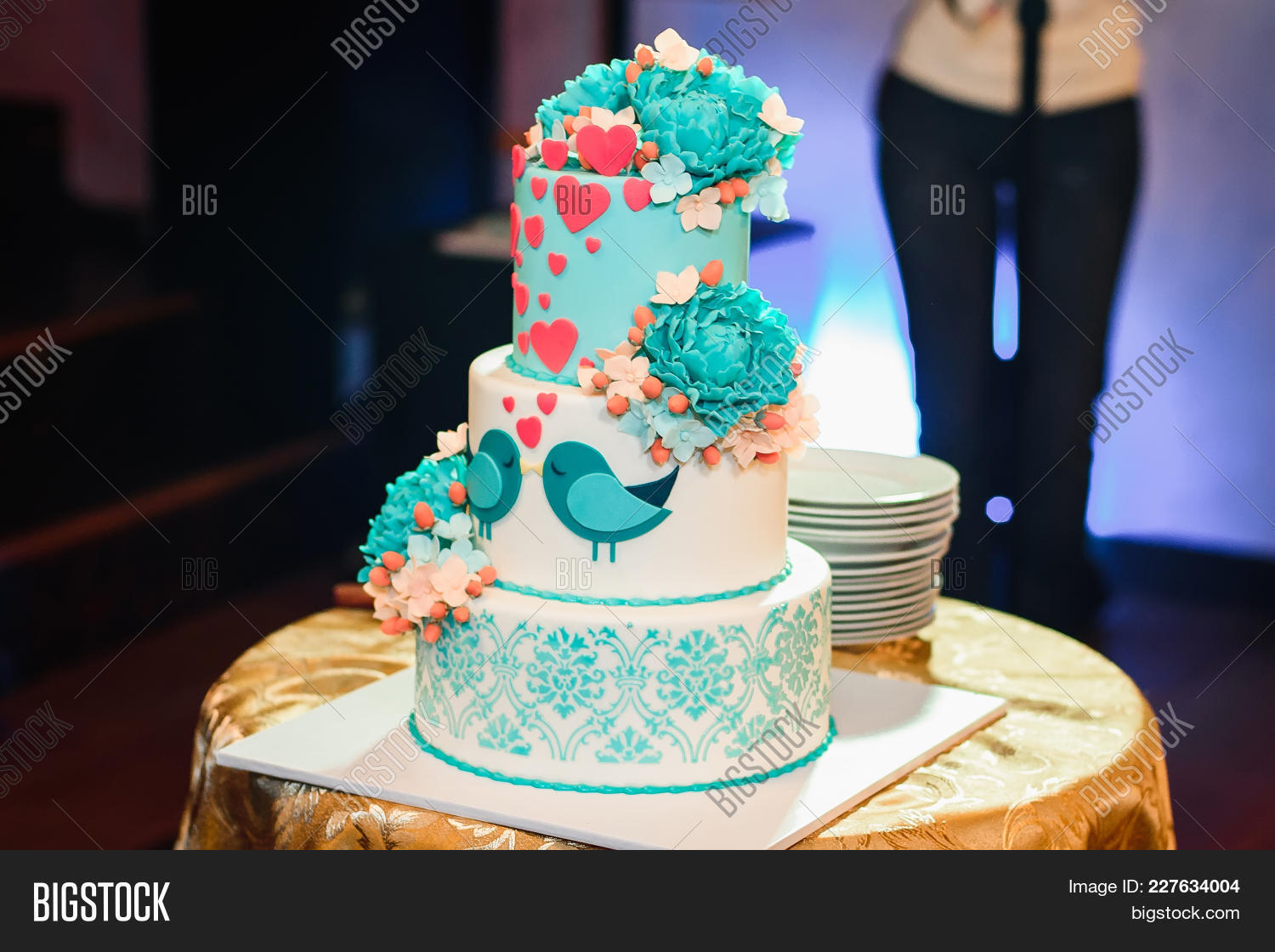Wedding cake three image photo free trial bigstock wedding cake with three tiers of white blue glaze decorated with flowers and hearts on the izmirmasajfo