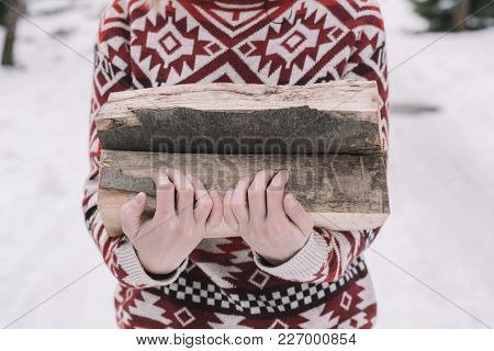 woman holding firewood outdoor
