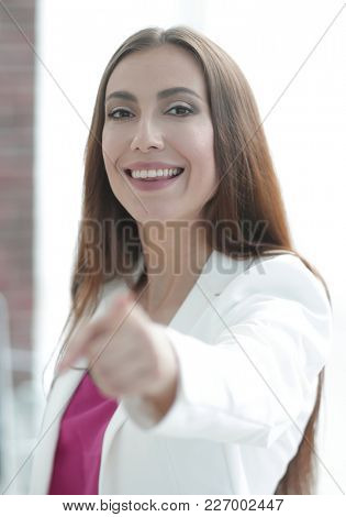 confident business woman pointing finger forward