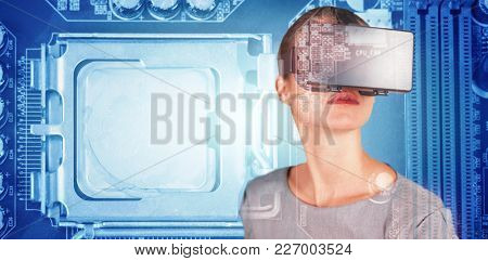 Close up of woman using virtual reality simulator against close-up of circuit board