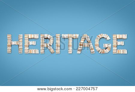 HERITAGE word formed from books, shot from above on light blue background