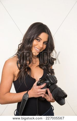 Beautiful smiling woman holding camera