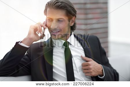 business man talking on smart phone.