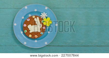 Cookie with various confectioneries in plate on wooden surface