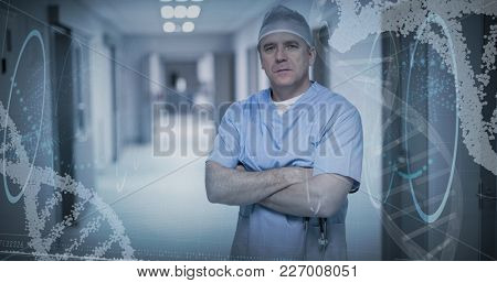 Blue spiral dna pattern on screen against portrait of surgeon standing with arms crossed