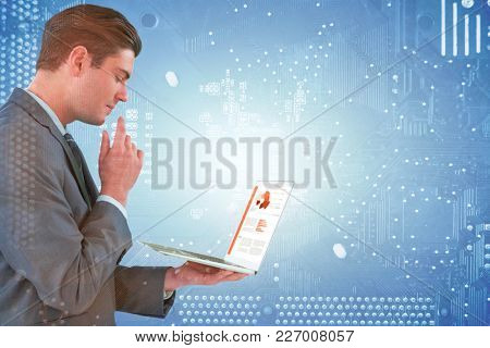 Businessman using laptop against micro parts of mother board