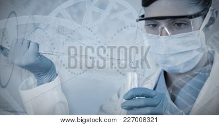 Female scientist holding laboratory glassware against red spiral dna pattern on screen