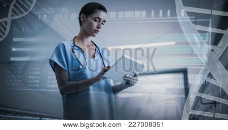 Genetic research information on DNA against serious female surgeon using digital tablet