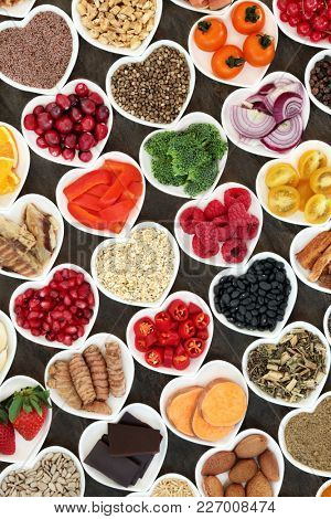 Super food nutrition for a healthy heart high in antioxidants, anthocyanins, fibre, vitamins and minerals with fruit, vegetables, pulses, fish, seeds, nuts, cereals and herbs used in herbal medicine.