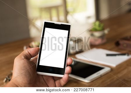 holding a smartphone with white screen