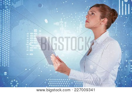 Businesswoman holding digital tablet against micro parts of mother board