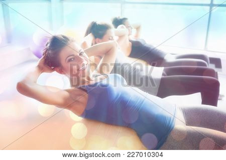 Abstract background against side view of women doing situps