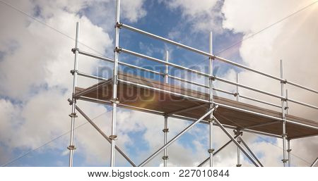 Digitally generated image of scaffoldings against blue sky with white clouds