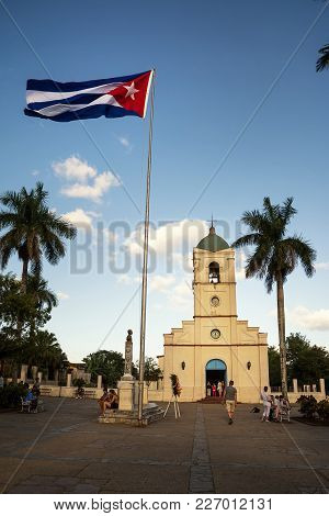 Vinales, Cuba - December 5, 2017: Main Squqare With Church And Cuban Flag At  Vinales With Tourist