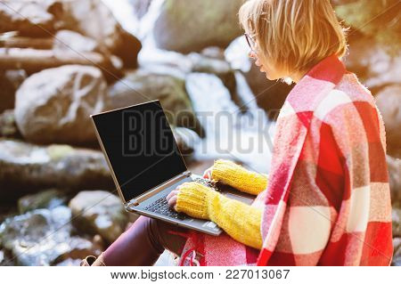 Mockup Image Of A Girl Wrapped In A Plaid Plaid With A Laptop With A Blank Black Desktop On Her Lap