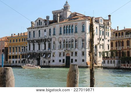 Venice, Italy - August 13, 2016: People In Pleasure Boat On Canal Of Venice
