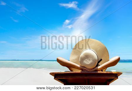 Bikini Woman Sexy In Relax Beach And Resting Resort In Vacation On Summer Season With Sunhat Sitting