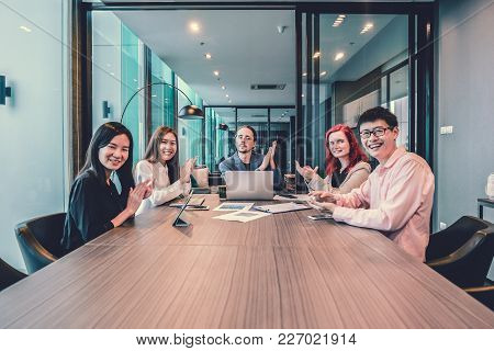 Group Of Business People Clapping Hands In A Meeting Room, Sharing Their Ideas, Multi Ethnic