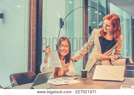 Business Women Talking To Each Other In Meeting Room, Multi Ethnic