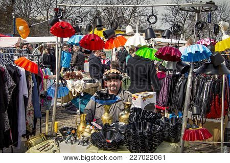 Berlin / Germany - March 27 2016: Funny Shopkeeper Among His Colorful Lampshades At The Mauerpark Su