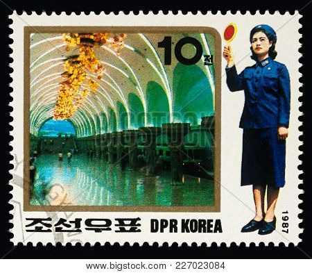 Moscow, Russia - February 16, 2018: A Stamp Printed In Dprk (north Korea), Shows Metro And Woman Tra