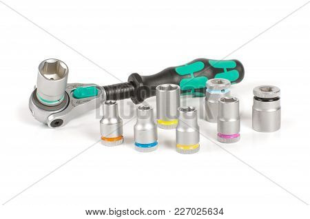 Socket Wrench With Various Bits On The White Background