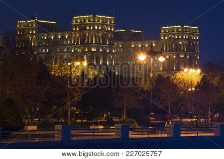 The Palace Of The Government Of Azerbaijan In A Night Landscape. View From Side Of The Seaside Park.