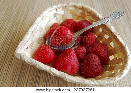 Small Basket Of Strawberries And With A Spoon