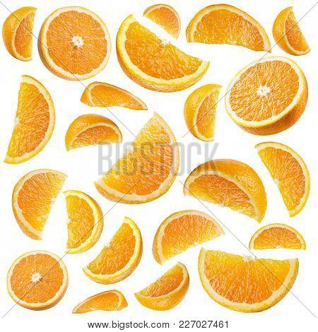 Set of ripe orange fruit and orange slices isolated on white.