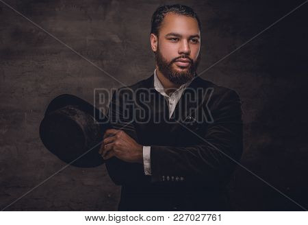 Bearded Black Man Wearing A Suit And A Felt Hat.