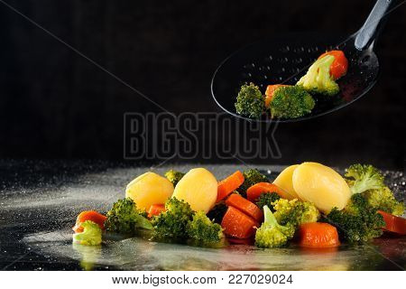 Closeup Shot Of Steamed Vegetables On Tray With Steam.