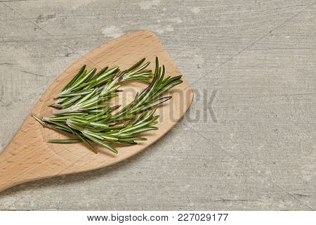 Wooden Spoon With Caraway And Rosemary, Onion, Garlic On Background. Top View.