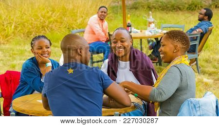 Johannesburg, South Africa, 05/09/2015,  Two African Couples Laughing Together At The Winter Sculptu