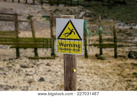 Sign: Warning Sudden Drop, Seen In Cuckmere Haven Near Seaford, East Sussex, Uk