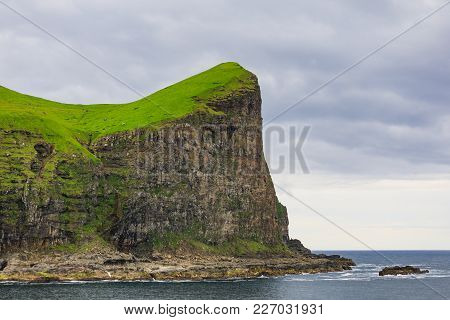 Landscape On The Faroe Islands With Ocean And Cliffs