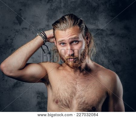 Positive, Gentle Redhead Bearded Male Posing In A Studio On Grey Background.
