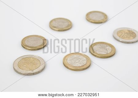 Coins Business Composition In A White Background