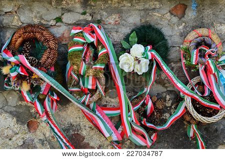 Mukachevo, Ukraine - August 23 , 2017 , Ribbon With National Colours Of Hungary Tied Up To The Flowe
