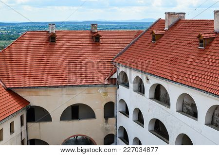 Mukachevo, Ukraine - August 23 , 2017 , Side View Of The Yard, Roof And Walls Of The Palanok Castle