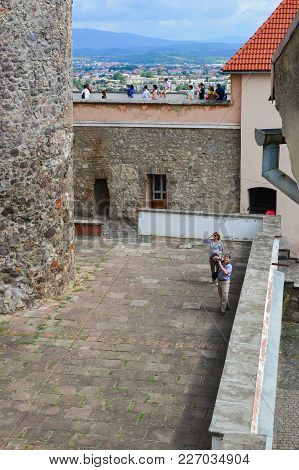 Mukachevo, Ukraine - August 23 , 2017 , Tourists Are Walking On The Fortress Walls And Yard Of The P