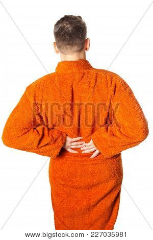 Young Man Having Severe Backache Posing In Bathrobe After Shower, Back View