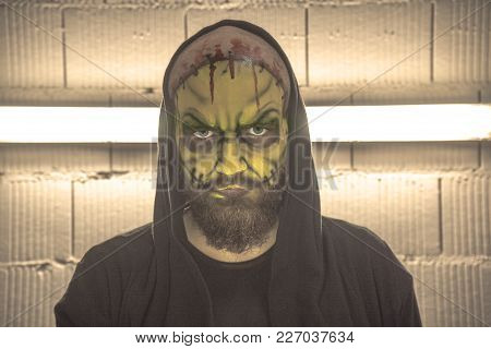 Make Up Green Skull. Portrait Of A Man Make Up A Skull. Bald Guy With Make Up. A Bearded Bald Man. S