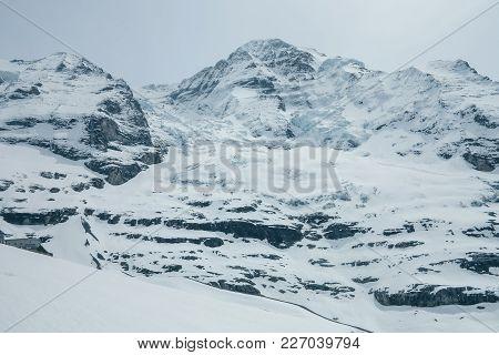 View On The Peak Of  The Biggest Glacier Of Jungfrau. Bernese Oberland, Switzerland. Swiss Alps