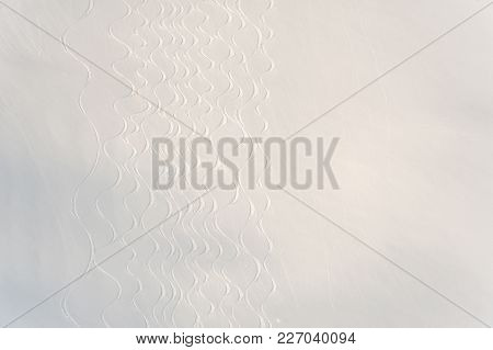 Perfect Fresh And Soft White Snow Surface With A Wavy Structure For The Background. Top View