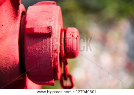Red Metallic Hydrant Closeup With Unfocused Background