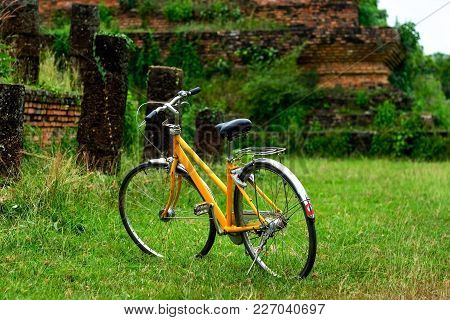 Vintage Bicycle On Green Meadow. Travel In Vacation In Asia